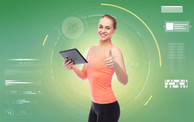 Jovem mulher desportivo de sorriso feliz com PC da tabuleta fotos de stock royalty free