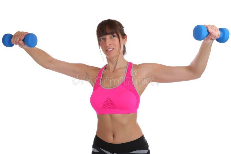 Jovem mulher do exercício da aptidão que guarda o exercício traseiro do ombro dos pesos fotos de stock royalty free
