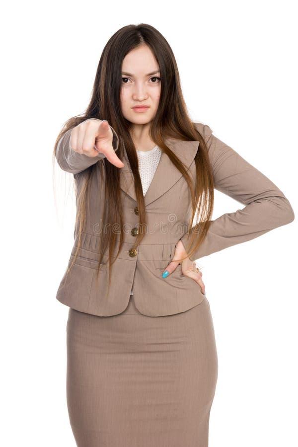 Jovem mulher do neg?cio que aponta o direito do dedo isolado sobre o fundo branco fotografia de stock royalty free