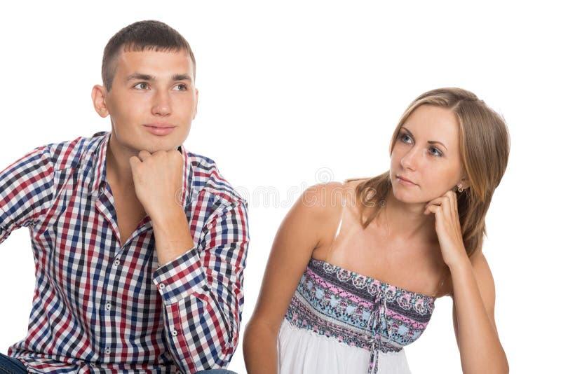 Jovem mulher e um homem que olha acima imagens de stock royalty free