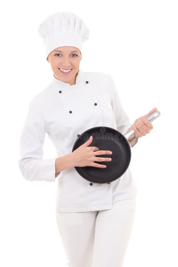 A jovem mulher engraçada na frigideira de jogo uniforme do cozinheiro chefe gosta de um guit imagem de stock royalty free