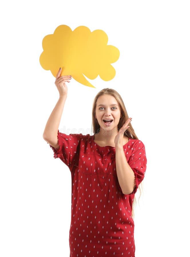 Jovem mulher entusiasmado com bolha vazia do discurso no fundo branco fotografia de stock