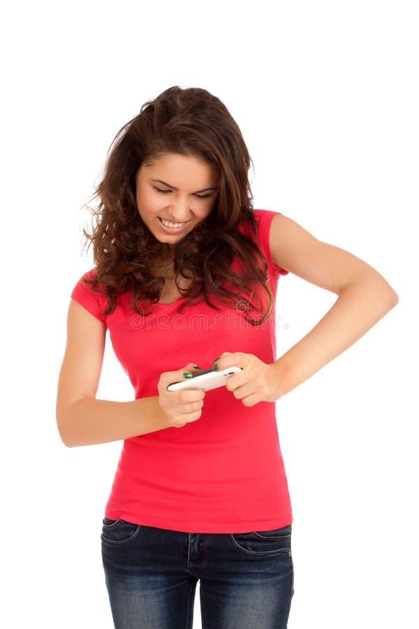 Mulher Excited que joga jogos no smartphone fotografia de stock royalty free
