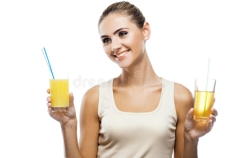 Jovem mulher feliz com suco de maçã imagem de stock royalty free