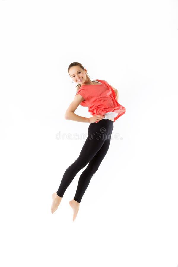 Jovem mulher feliz de salto, isolada no branco fotos de stock royalty free