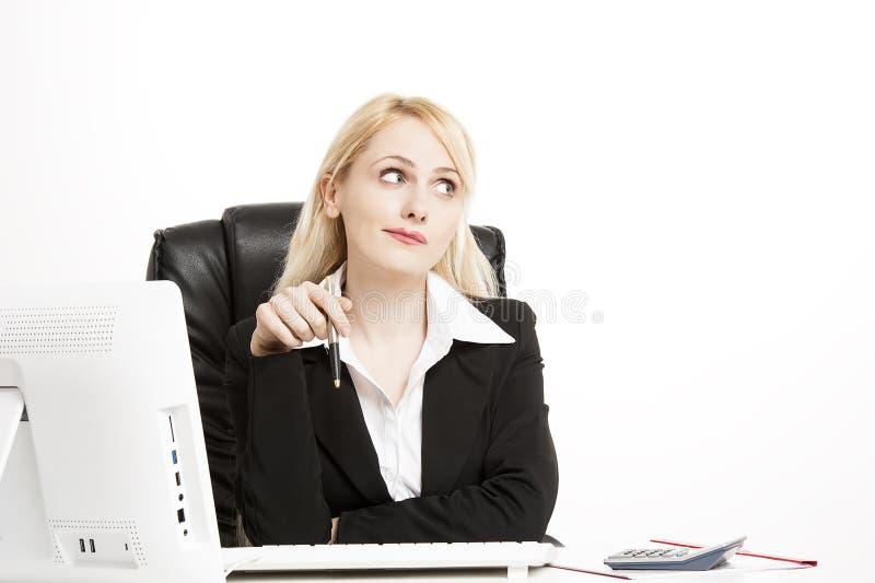 Jovem mulher forçada no trabalho fotos de stock royalty free