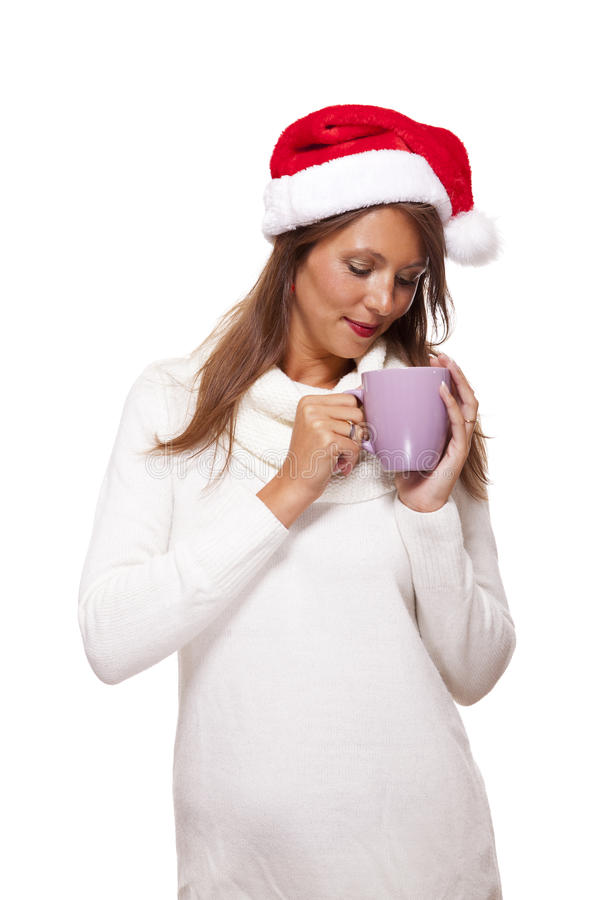 Jovem mulher fria em um chá sorvendo do café do chapéu de Santa fotos de stock