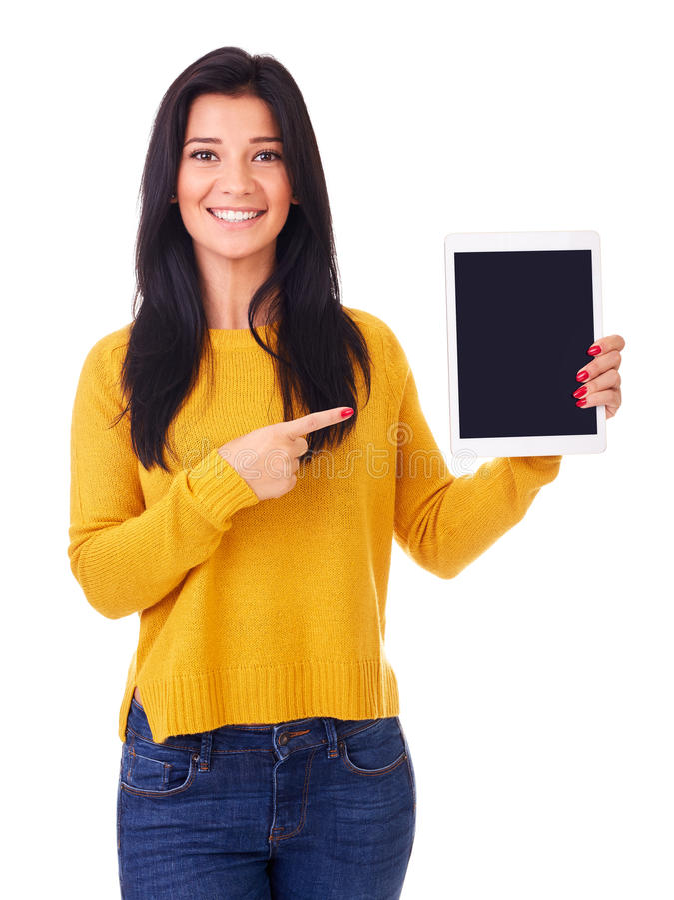 A jovem mulher mostra o tela táctil imagem de stock