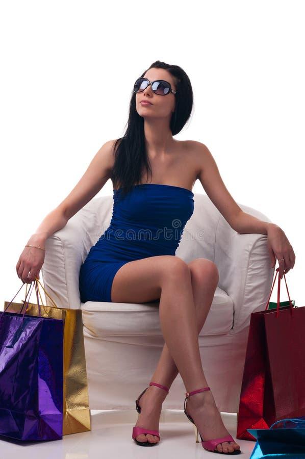 Jovem mulher na cadeira imagens de stock royalty free