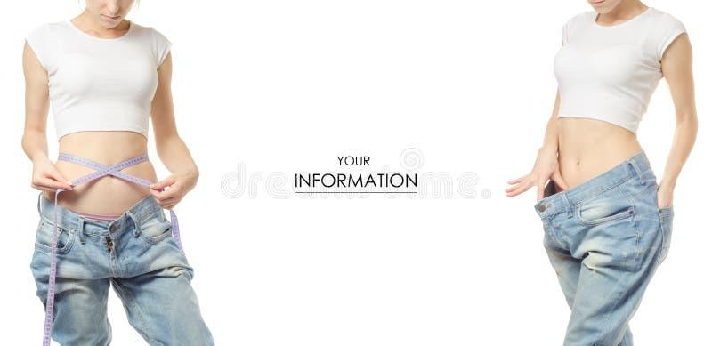 Jovem mulher na perda de peso da perda de peso das calças de brim com um teste padrão ajustado do centímetro fotos de stock