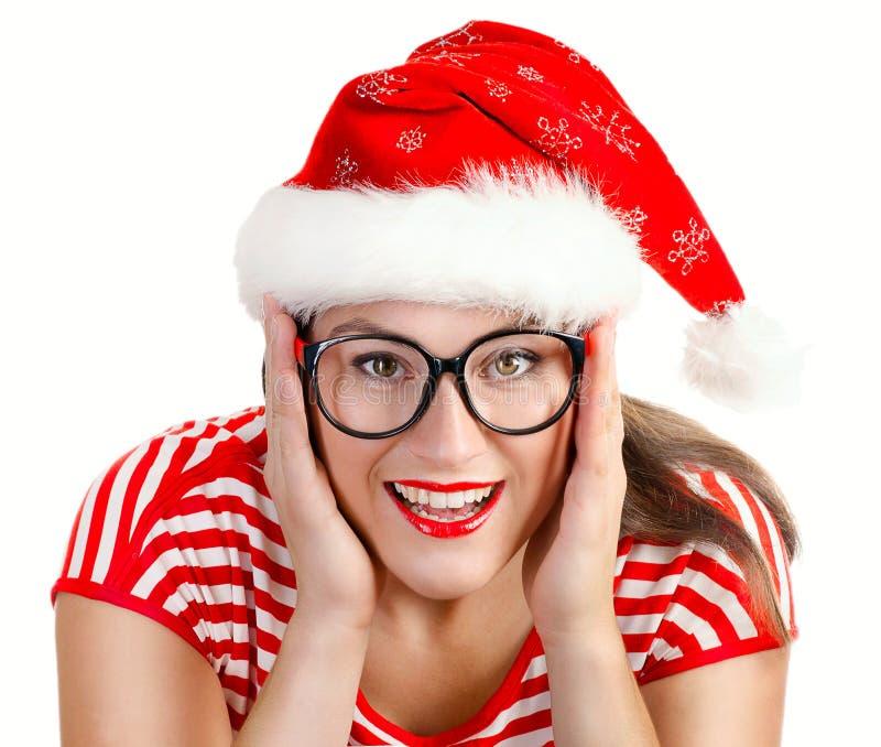 Jovem mulher no chapéu de Santa, isolado em um branco foto de stock