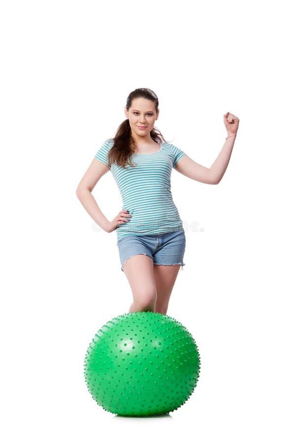 A jovem mulher no conceito dos esportes isolada no branco imagem de stock