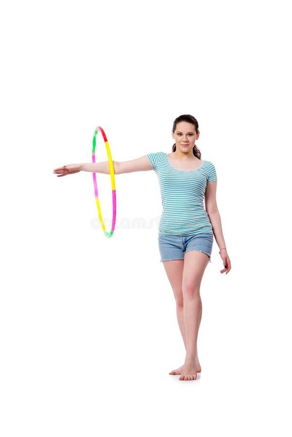 A jovem mulher no conceito dos esportes isolada no branco imagens de stock royalty free