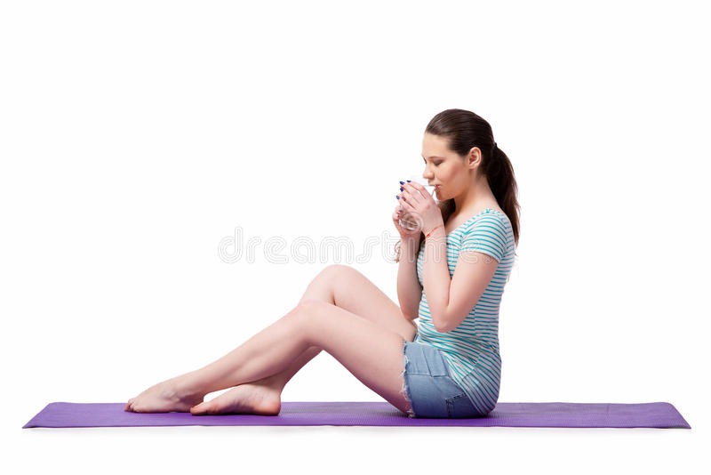 A jovem mulher no conceito dos esportes isolada no branco imagem de stock royalty free