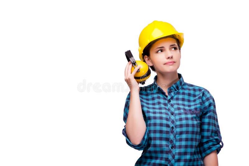 A jovem mulher no conceito industrial isolada no branco imagens de stock