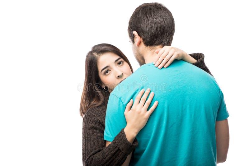 Jovem mulher no relacionamento infeliz imagens de stock