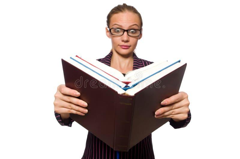 A jovem mulher no traje roxo que guarda livros imagem de stock