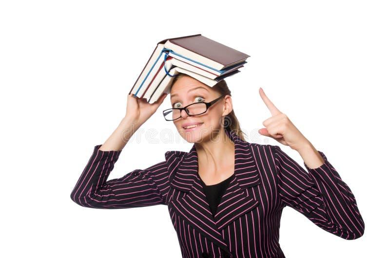 A jovem mulher no traje roxo que guarda livros fotos de stock