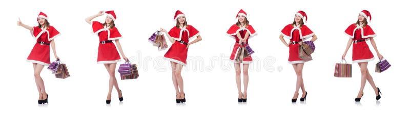 A jovem mulher no traje vermelho de Santa no branco imagens de stock royalty free