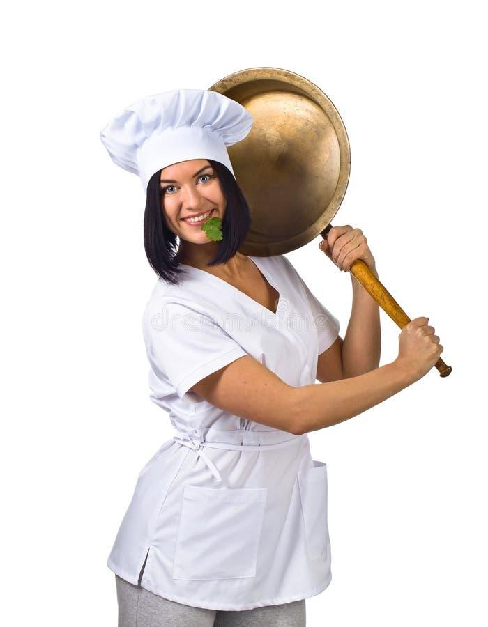 Jovem mulher no uniforme do cozinheiro chefe com a bandeja isolada no branco fotos de stock