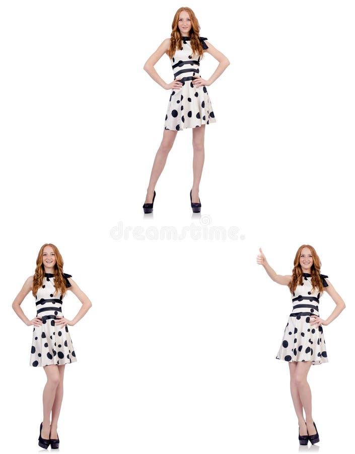 A jovem mulher no vestido do às bolinhas isolado no branco imagens de stock