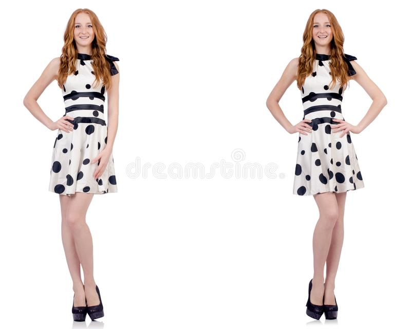 A jovem mulher no vestido do às bolinhas isolado no branco imagem de stock