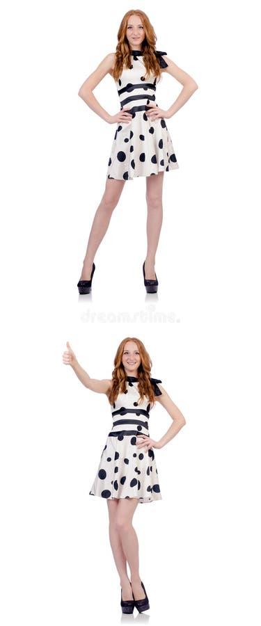 A jovem mulher no vestido do às bolinhas isolado no branco foto de stock