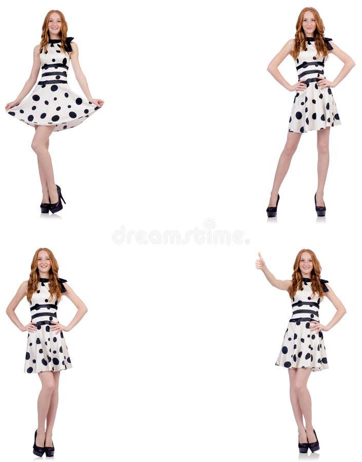A jovem mulher no vestido do às bolinhas isolado no branco ilustração do vetor