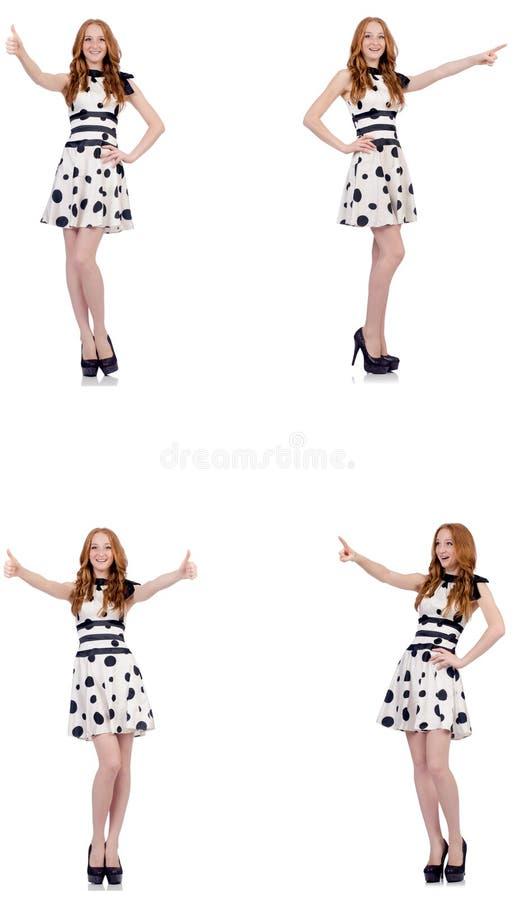A jovem mulher no vestido do às bolinhas isolado no branco ilustração royalty free