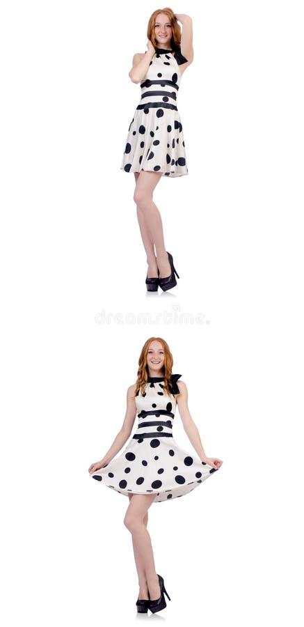 A jovem mulher no vestido do ?s bolinhas isolado no branco ilustração stock