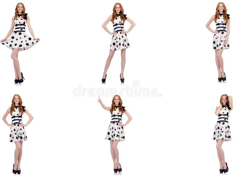 A jovem mulher no vestido do ?s bolinhas isolado no branco foto de stock