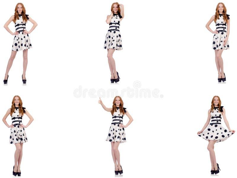A jovem mulher no vestido do ?s bolinhas isolado no branco fotos de stock