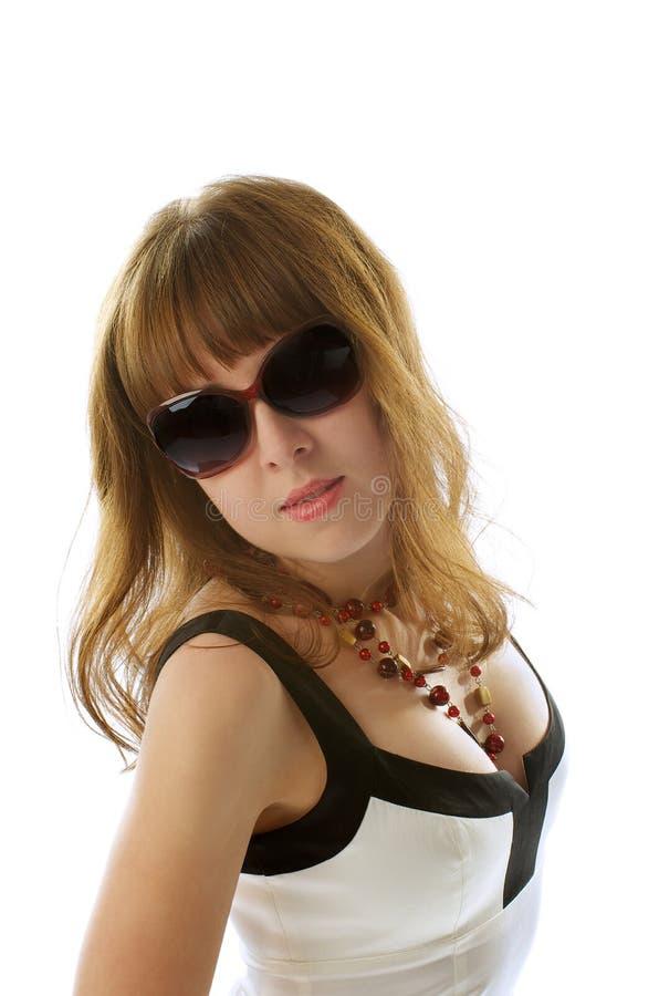 Jovem mulher nos óculos de sol imagem de stock
