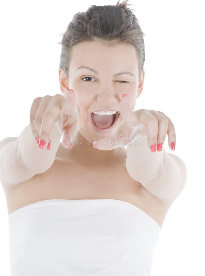 Jovem mulher que aponta seu dedo sobre o branco imagem de stock royalty free