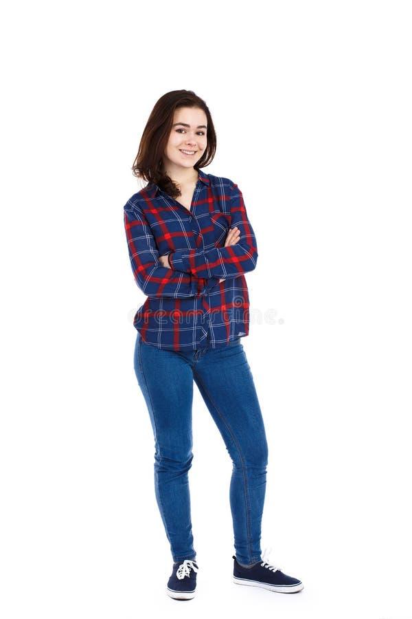 Jovem mulher que está no fundo branco foto de stock