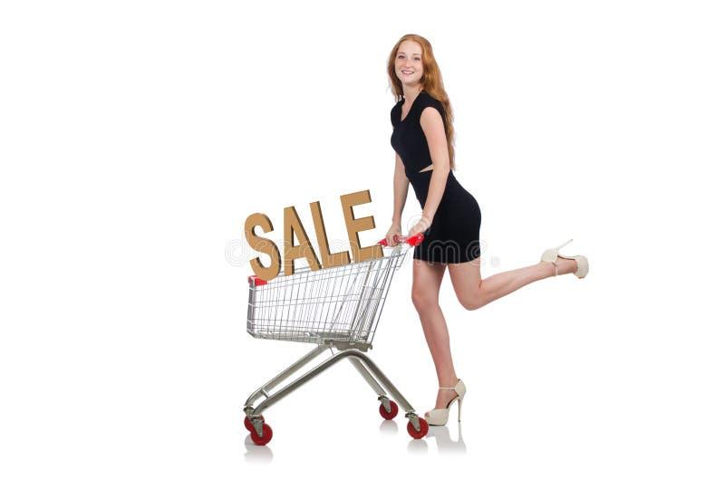 A jovem mulher que faz a compra isolada no branco foto de stock