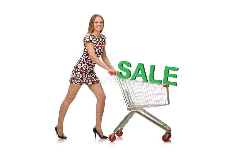 A jovem mulher que faz a compra no branco fotografia de stock royalty free