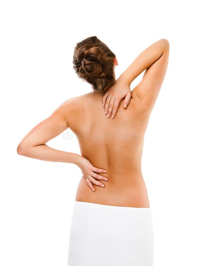 Mulher que faz massagens a parte traseira da dor imagens de stock royalty free