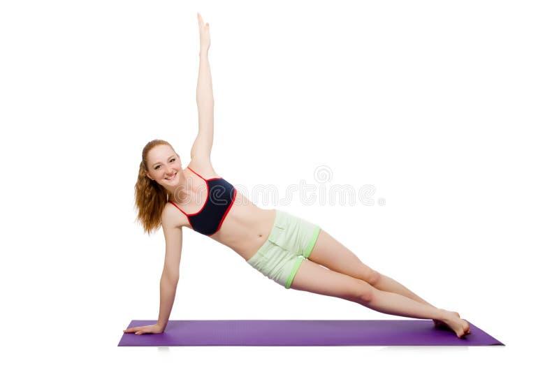 Jovem mulher que faz os exercícios do esporte isolados foto de stock royalty free