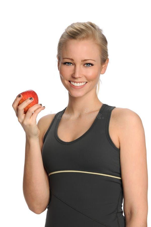 Jovem mulher que guarda Apple imagens de stock
