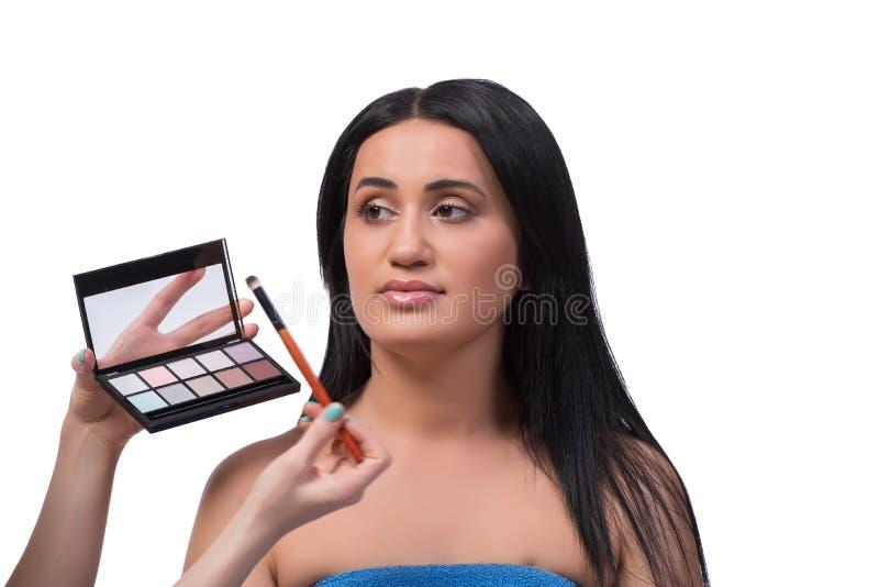 A jovem mulher que obtém a composição isolada no branco imagem de stock royalty free