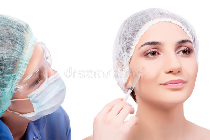A jovem mulher que prepara-se para a cirurgia plástica isolada no branco fotos de stock royalty free
