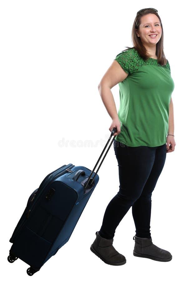 Jovem mulher que puxa o holida de viagem das férias do curso da bagagem do saco foto de stock royalty free