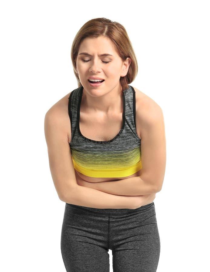 Jovem mulher que sofre da dor abdominal foto de stock royalty free