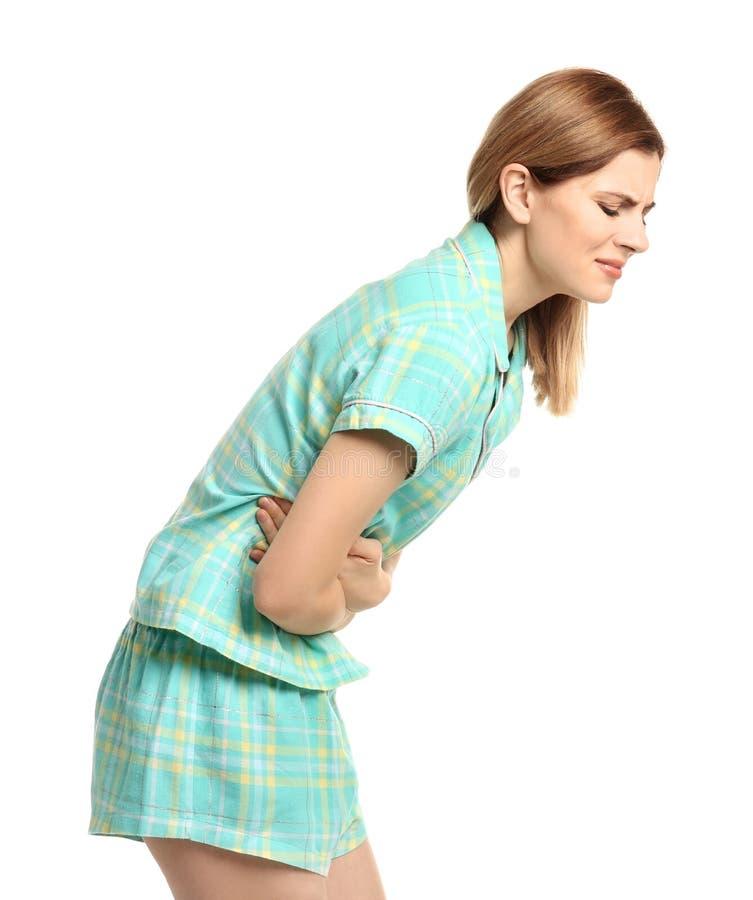 Jovem mulher que sofre da dor abdominal imagens de stock