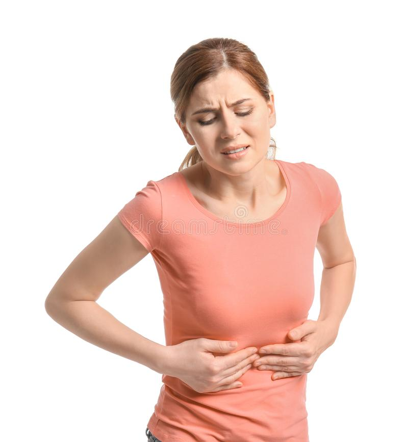 Jovem mulher que sofre da dor abdominal foto de stock