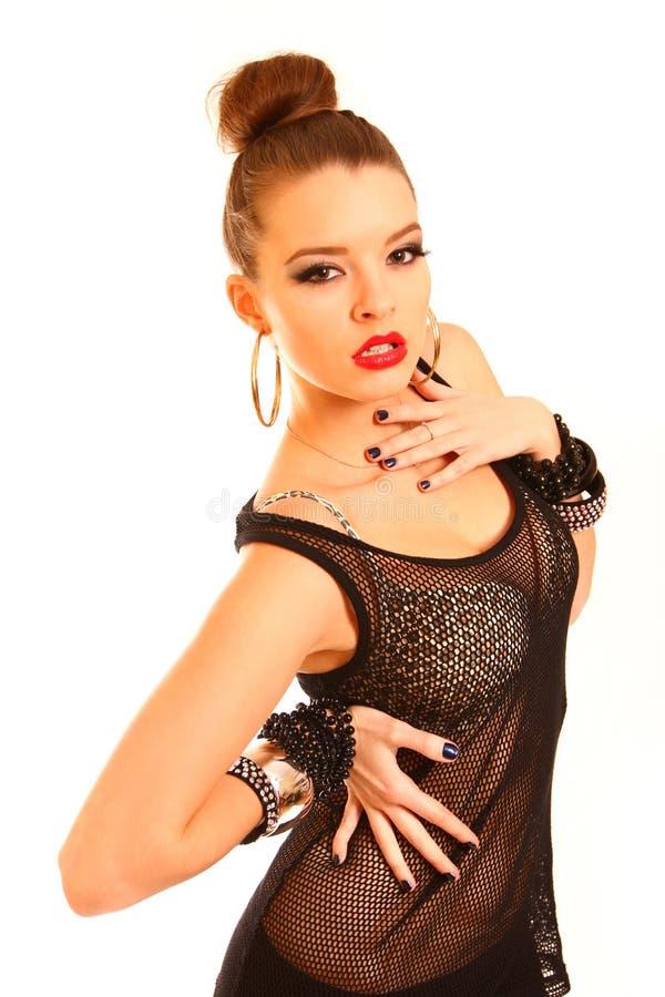 Jovem mulher sensual que toca em seu corpo com as mãos isoladas no whi imagens de stock royalty free