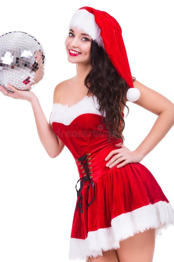 Jovem mulher 'sexy' no traje e no chapéu do Natal imagem de stock