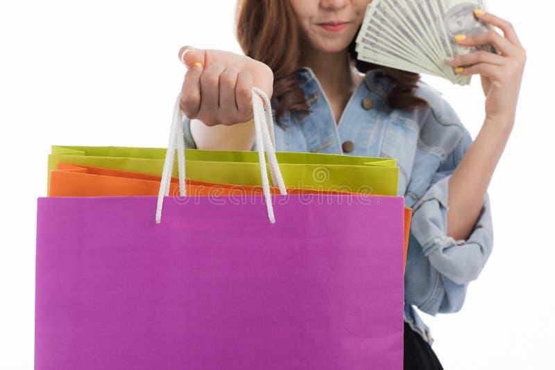 Jovem senhora com sacos de compras fotografia de stock