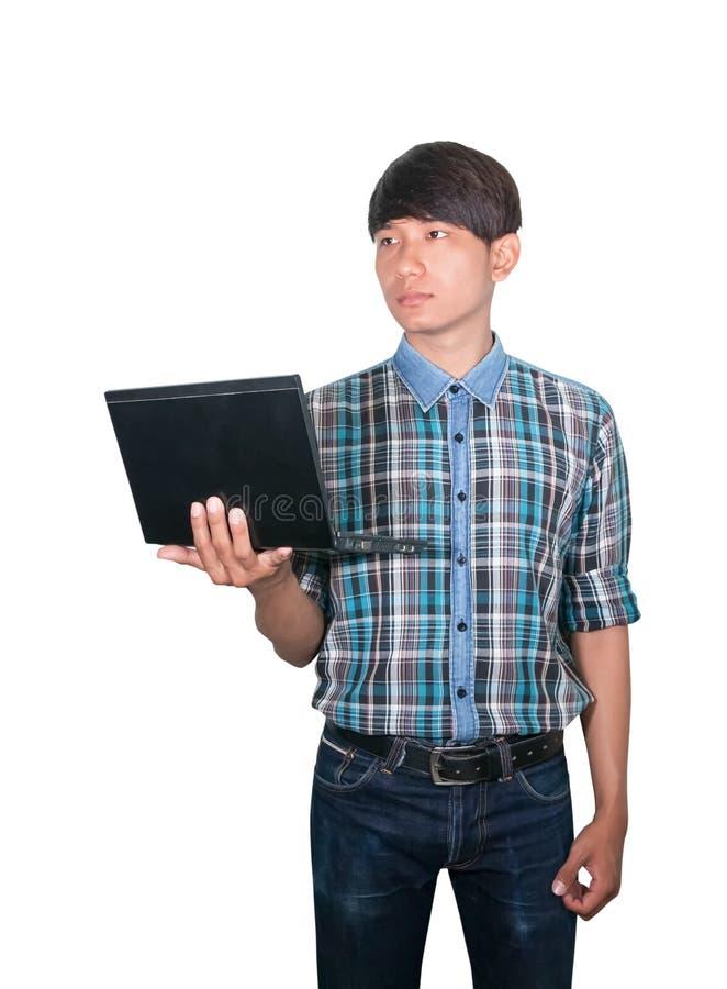 Joven hermoso del hombre de negocios usando el ordenador port?til en el fondo blanco foto de archivo libre de regalías